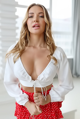 Yulia takes off her white shirt and red skirt in a penthouse