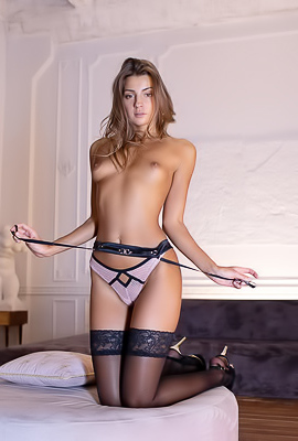 Melena A flaunting her sexy figure while in stockings and high heels